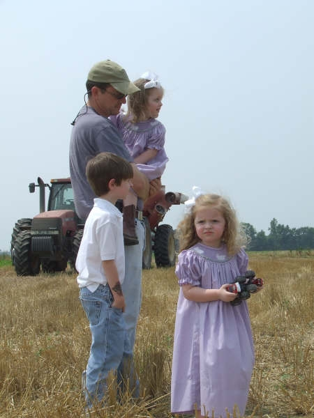 Cole Sims with Children in Wheat Field